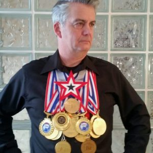 Sword Swallower Brad Byers World Record Medals